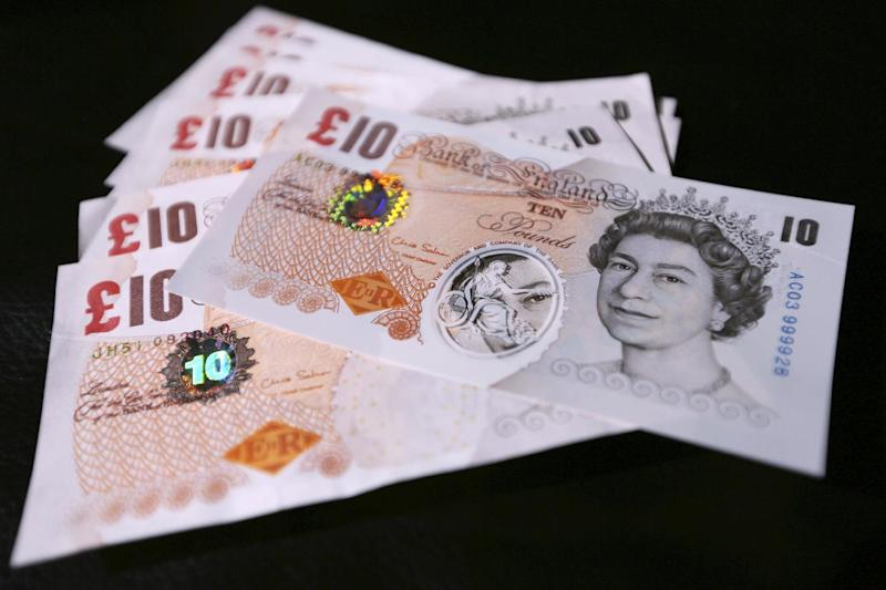 """A sample the proposed new British banknotes made of a polymer, with ten pound notes arranged for a photograph during a news conference at the Bank of England in London, Tuesday, Sept. 10, 2013. Bank of England Deputy Governor Charlie Bean, said: """"Polymer banknotes are cleaner, more secure and more durable than paper money"""", but the bank said Tuesday it will hold public consultations to consider the change. (AP Photo / Chris Ratcliffe)"""