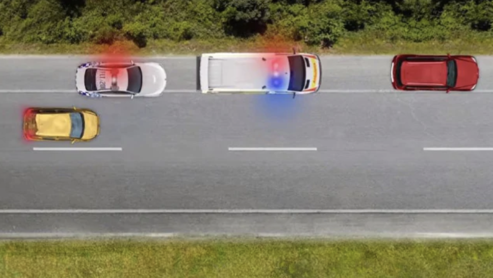 NSW drivers will be obliged to create as much space as possible. An image of a car passing two emergency services vehicles.