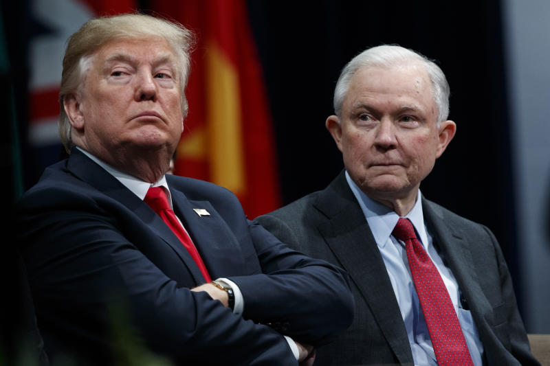 FILE - In this Dec. 15, 2017, file photo, President Donald Trump sits with Attorney General Jeff Sessions during the FBI National Academy graduation ceremony in Quantico, Va. Late last year, lawyers for Trump expressed optimism that special counsel Robert Mueller was nearing the end of his probe of Russia's interference in the 2016 election. But if there was hope in the White House that Trump might be moving past an investigation that has dogged his presidency from the start, 2018 is beginning without signs of abatement.(AP Photo/Evan Vucci, File)