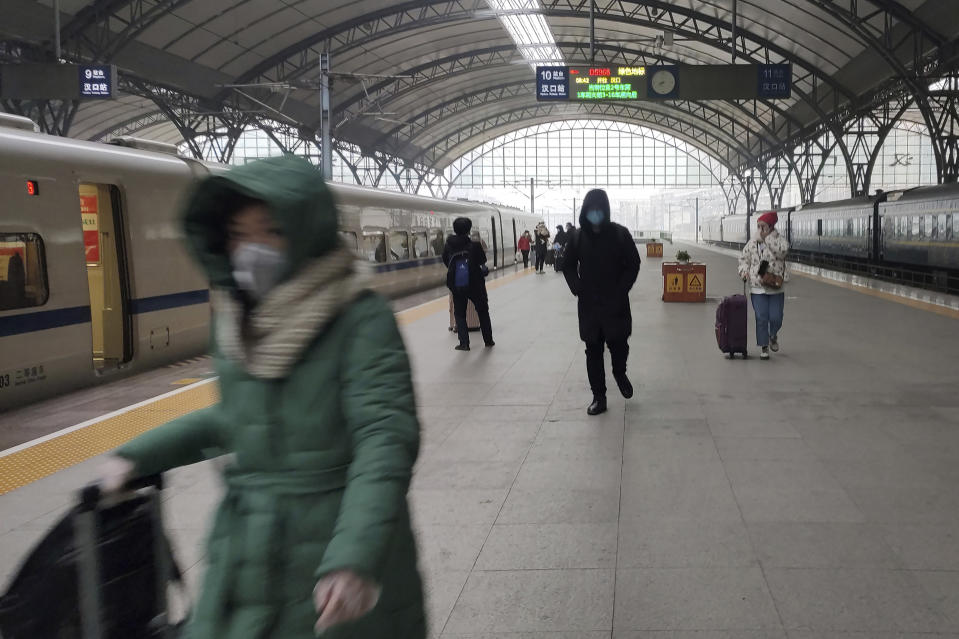 Travelers walk along a platform at the Hankou Railway Station shortly before it was closed in Wuhan.