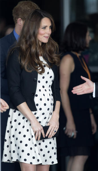 """FILE - In this Friday, April 26, 2013 file photo Kate the Duchess of Cambridge leaves after attending the inauguration of """"Warner Bros. Studios Leavesden"""" near Watford, approximately 18 miles north west of central London. By the time you're reading this, the Duchess of Cambridge could be in labor. Or it could be a matter of hours. Or days. Or weeks. As Britain's Prince William and his wife, Kate, await the birth of their first child _ and the next heir to the English throne _ some are convinced the royal due date has already passed, even though the Palace has not given an exact date. Many in the British media predicted the baby would be born last week and the Prince himself is now on official leave. (AP Photo/Matt Dunham, File)"""