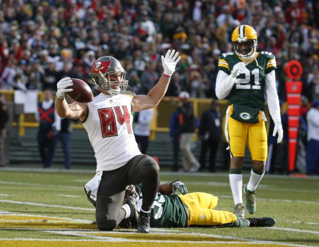 <p>Tampa Bay Buccaneers' Cameron Brate celebrates after catching a touchdown pass during the first half of an NFL football game against the Green Bay Packers Sunday, Dec. 3, 2017, in Green Bay, Wis. (AP Photo/Mike Roemer) </p>