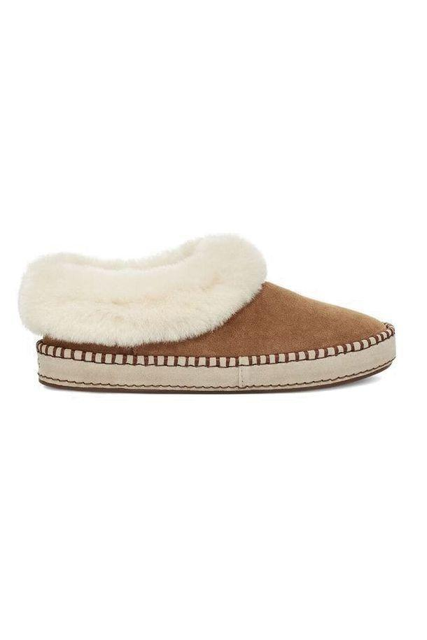 """<p><strong>UGG</strong></p><p>amazon.com</p><p><strong>$99.95</strong></p><p><a href=""""https://www.amazon.com/dp/B083RTKYVS?tag=syn-yahoo-20&ascsubtag=%5Bartid%7C10051.g.13053688%5Bsrc%7Cyahoo-us"""" rel=""""nofollow noopener"""" target=""""_blank"""" data-ylk=""""slk:Shop Now"""" class=""""link rapid-noclick-resp"""">Shop Now</a></p><p>Gift a woman in your who rarely treats herself to a pair of Ugg slippers that will <a href=""""https://www.elle.com/fashion/shopping/a30170284/ugg-best-slippers-review/"""" rel=""""nofollow noopener"""" target=""""_blank"""" data-ylk=""""slk:change her life"""" class=""""link rapid-noclick-resp"""">change her life</a>. (Or at the very least, keep her toes warm for all winter long.)</p>"""