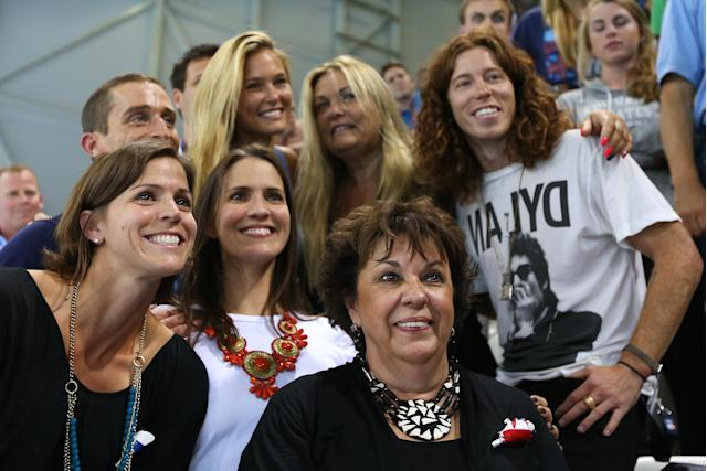 Debbie Phelps (C) the mother of Michael Phelps of the United States and his sisters Whitney Phelps (L) and Hilary Phelps (2nd L), snowboarder Shaun White of the United States and model Bar Refaeli (top C) pose on Day 4 of the London 2012 Olympic Games at the Aquatics Centre on July 31, 2012 in London, England. (Photo by Ezra Shaw/Getty Images)