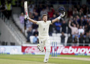 England captain Joe Root celebrates scoring a century during the second day of third test cricket match between England and India, at Headingley cricket ground in Leeds, England, Thursday, Aug. 26, 2021. (AP Photo/Jon Super)