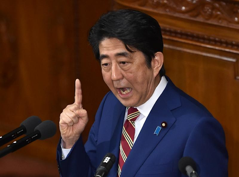 "A legislator from the party of Prime Minister Shinzo Abe (pictured) said Barack Obama carried the ""blood of ... slaves"" (AFP Photo/Kazuhiro Nogi)"