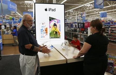 A Walmart employee explains Apple iPad options to a customer at a Walmart Supercenter in Rogers