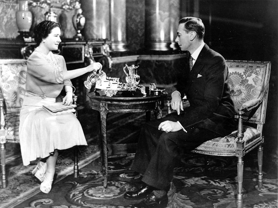 <p>King George VI and Queen Elizabeth (later known as the Queen Mother) enjoy tea in their Buckingham Palace rooms during their Silver Wedding celebrations.</p>