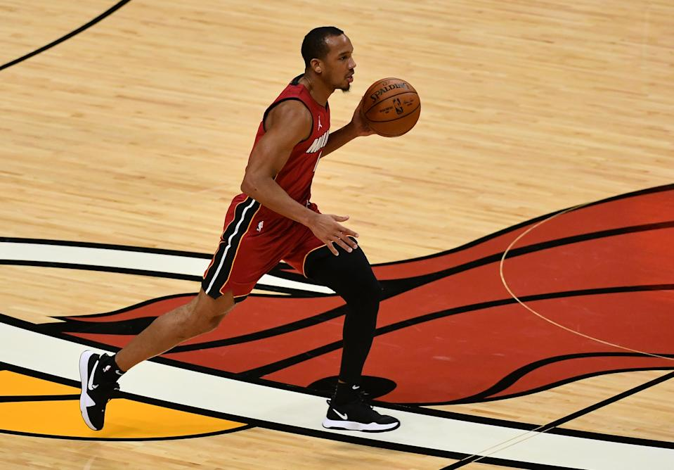 Dec 25, 2020; Miami, Florida, USA; Miami Heat guard Avery Bradley (11) dribbles the ball against the New Orleans Pelicans during the second half at American Airlines Arena.