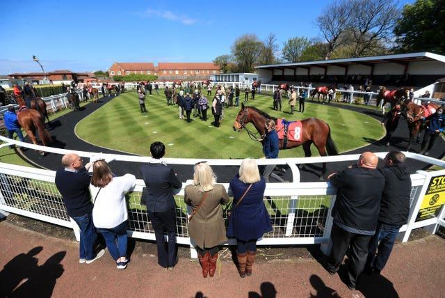 Racegoers inspect the parade ring at Redcar Racecourse