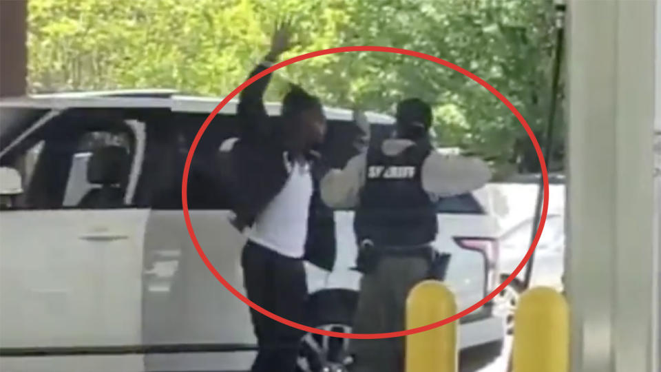 Chiefs defensive back Bashaud Breeland raising his hands as he is arrested at gun point.