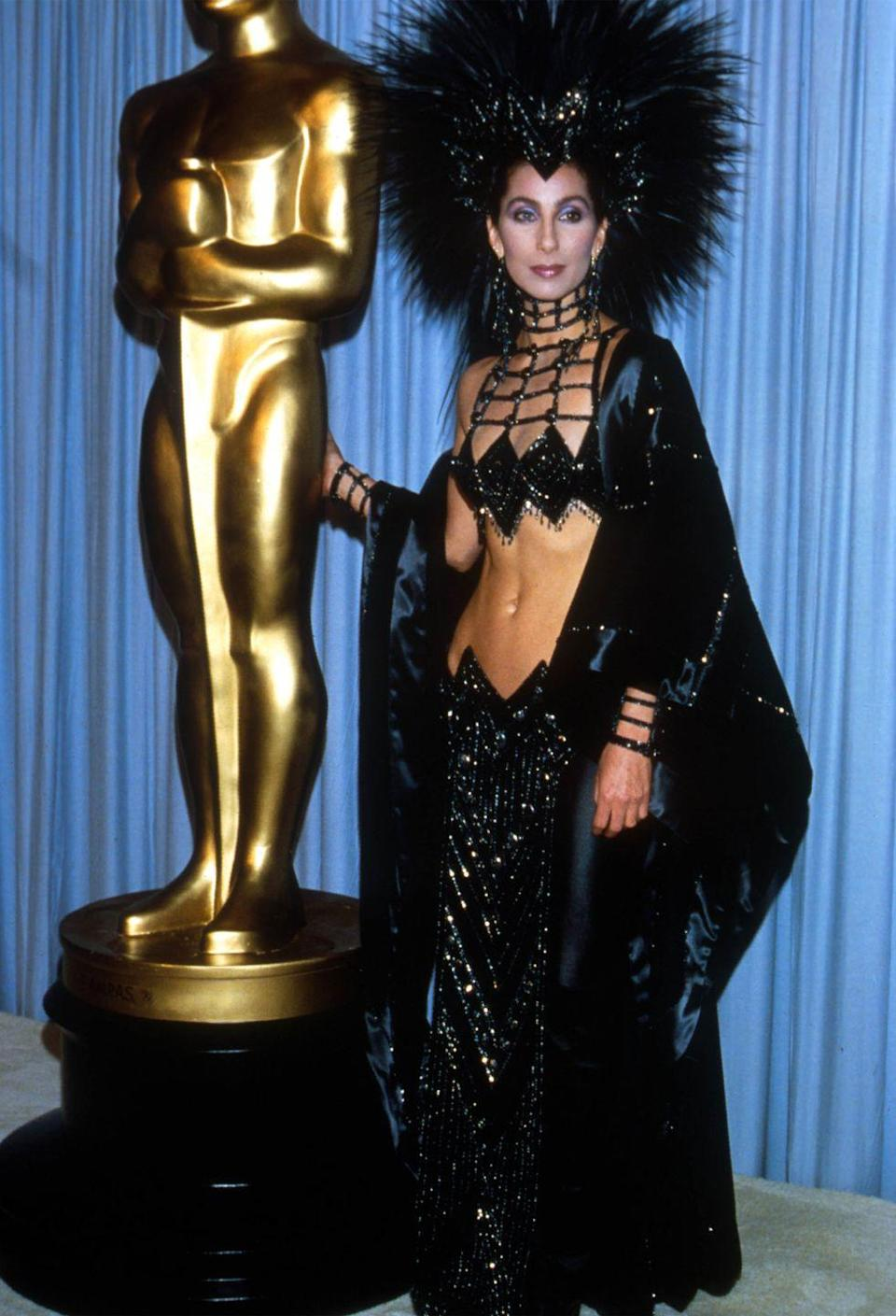 <p>For one of her most memorable and iconic red carpet looks of all time, Cher wore a sparkling showgirl-inspired two-piece set and towering headpiece by Bob Mackie to the Oscars because the Academy didn't take her as a serious actress. </p>