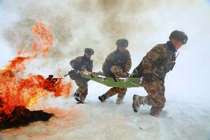 Soldiers go through field exercises in the snow near the Kunjerab Pass bordering Pakistan in Taxkorgan in northwest China's Xinjiang Uyghur Autonomous Region on Jan. 6, 2021. China appointed on Friday, Aug. 6, 2021 a new military commander in restive Xinjiang where authorities have locked up more than a million members of Muslim minorities in what they call a bid to curb terrorism and radicalism. (Chinatopix via AP) CHINA OUT