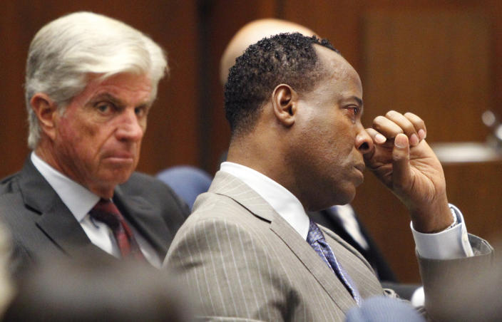 Conrad Murray wipes a tear during the defense opening arguments in his involuntary manslaughter trial at Superior Court, Tuesday, Sept. 27, 2011 in Los Angeles. Murray has pleaded not guilty and faces four years in prison and the loss of his medical license if convicted of involuntary manslaughter in Michael Jackson's death.
