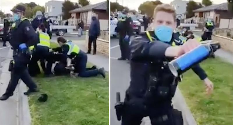 The man is forced to the ground while another officer raises a can of pepper spray at a gathered crowd. Source: Facebook