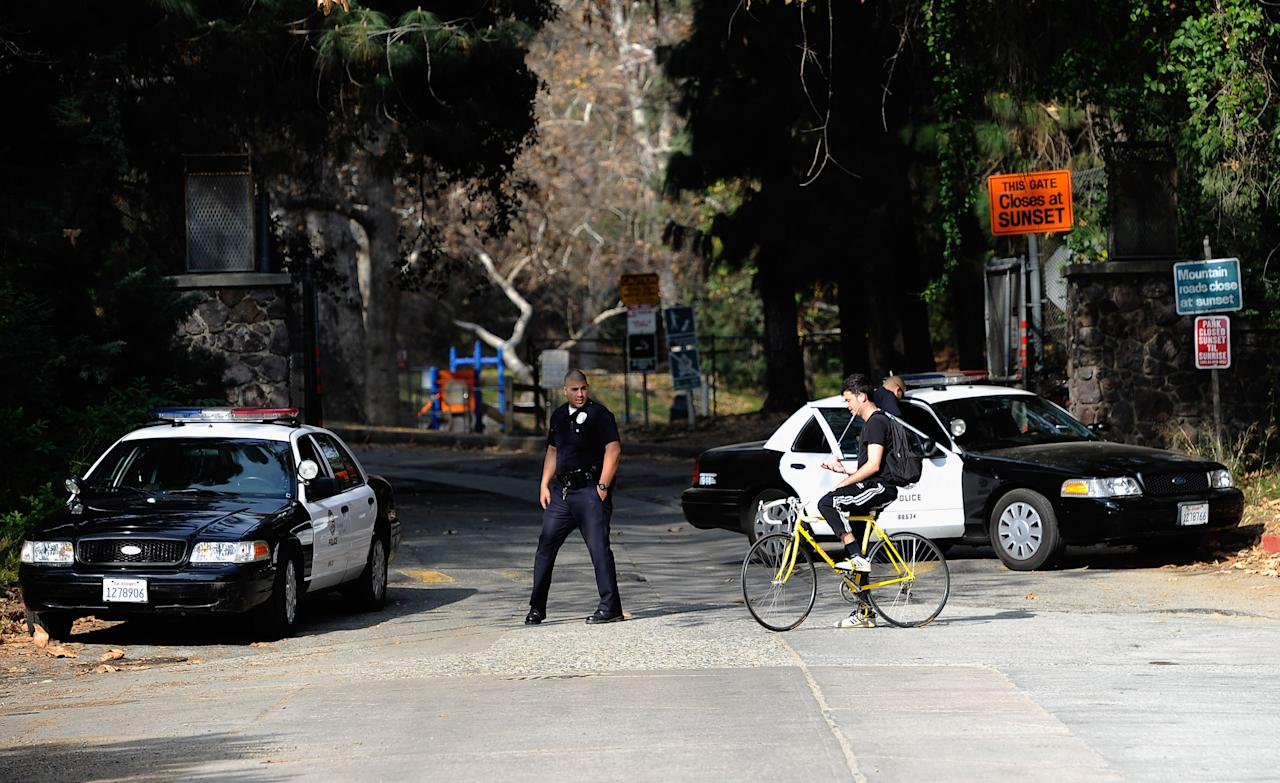 LOS ANGELES, CA - JANUARY 19:  Los Angeles Police Department officers guard the entrance to Bronson Park where a massive search continues to find body parts near the Hollywood sign on January 19, 2012 in Los Angeles, California. LAPD investigators resumed their search for more body parts, following the discovery of two feet and hands in the area where a man's head was found in a bag.  (Photo by Kevork Djansezian/Getty Images)