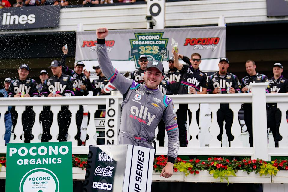 Alex Bowman celebrates with his crew after winning Saturday's NASCAR Cup Series race at Pocono Raceway.