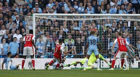 Britain Football Soccer - Arsenal v Manchester City - FA Cup Semi Final - Wembley Stadium - 23/4/17 Arsenal's Alexis Sanchez scores their second goal Action Images via Reuters / John Sibley Livepic