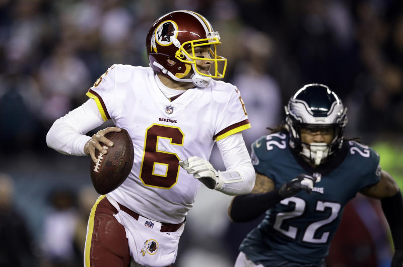 Washington Redskins quarterback Mark Sanchez looks to pass during an NFL football game against the Philadelphia Eagles, Philadelphia. The 32-year-old Sanchez hasn't won a regular-season start in