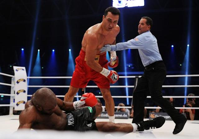 Ukrainian heavyweight boxing world champion Wladimir Klitschko knocks out French challenger Jean-Marc Mormeck in the IBF, IBO, WBO and WBA title bout at the Esprit arena in the western German city of Duesseldorf on March 3, 2012. TOPSHOTS AFP PHOTO / PATRIK STOLLARZ