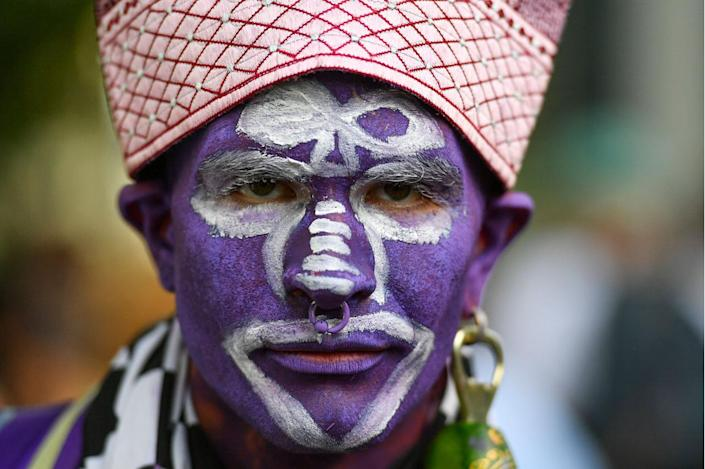 """<p>BJ Dini, of Los Angeles, Ca., is dressed as the """"Purple Man"""" during """"The Climate Revolution Is Up To Us"""" rally at Vernon Park on the eve of the Democratic National Convention on July 24, 2016 in Philadelphia, Pa. (Ricky Carioti/The Washington Post via Getty Images)</p>"""