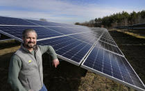 Mike Lucini, vice president of ISM Solar, poses, Tuesday Jan. 26, 2021, in Burrillville, R.I., at ISM's 10-acre solar farm which is the first of its kind in the state. U.S. President Joe Biden wants to change the way the U.S. uses energy by expanding renewables, but faces several challenges. (AP Photo/Elise Amendola)