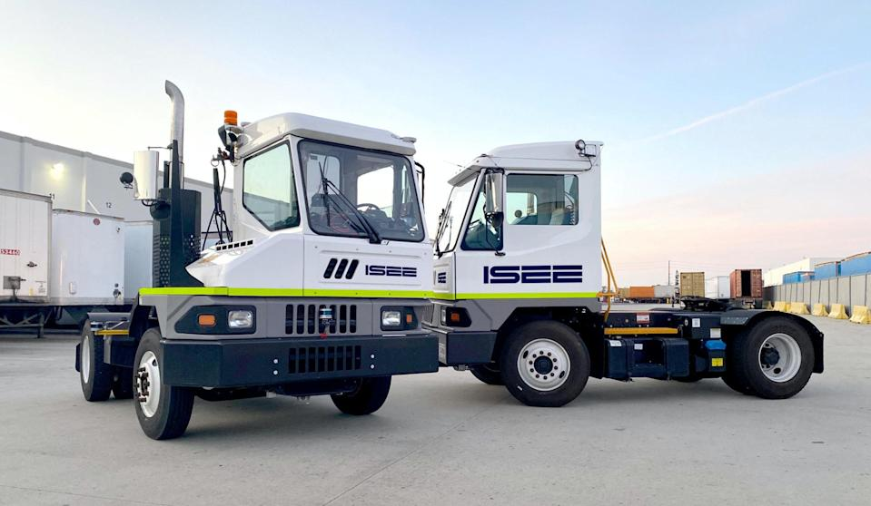 Two ISEE trucks without containers on the back.