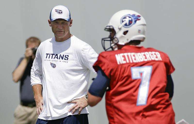 Tennessee Titans head coach Ken Whisenhunt watches as quarterback Zach Mettenberger (7) throws during NFL football minicamp on Tuesday, June 17, 2014, in Nashville, Tenn