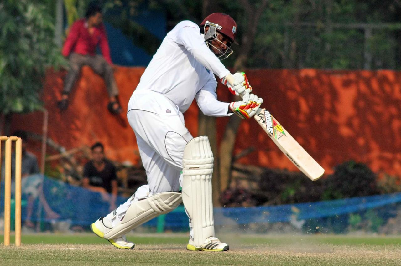 West Indies player Chris Gayle in action during Day 3 of practice match between West Indies and Uttar Pradesh Cricket Association XI at the Jadavpur University Ground in Kolkata on Nov.2, 2013. (Photo: IANS)