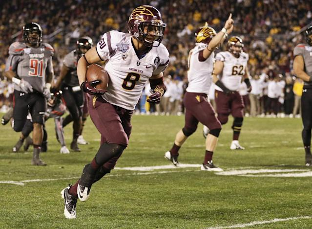 Arizona State running back D.J. Foster runs 20 yards for a touchdown against Texas Tech during the first half of the Holiday Bowl NCAA college football football game Monday, Dec. 30, 2013, in San Diego. (AP Photo/Gregory Bull)