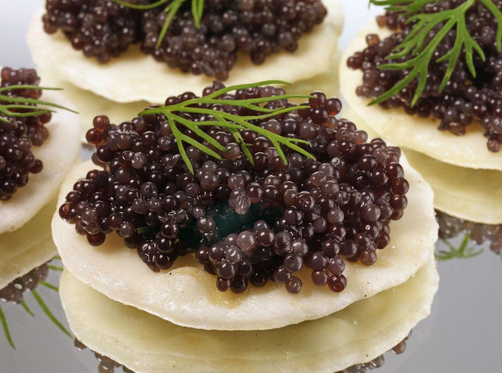 <p>Definitely one for special occasions, you'll certainly be showing that special someone you've pushed the boat out if you serve up caviar. Why not serve up some canapes complete with a nicely-paired wine or champagne? [Photo: Food and Drink/REX/Shutterstock] </p>