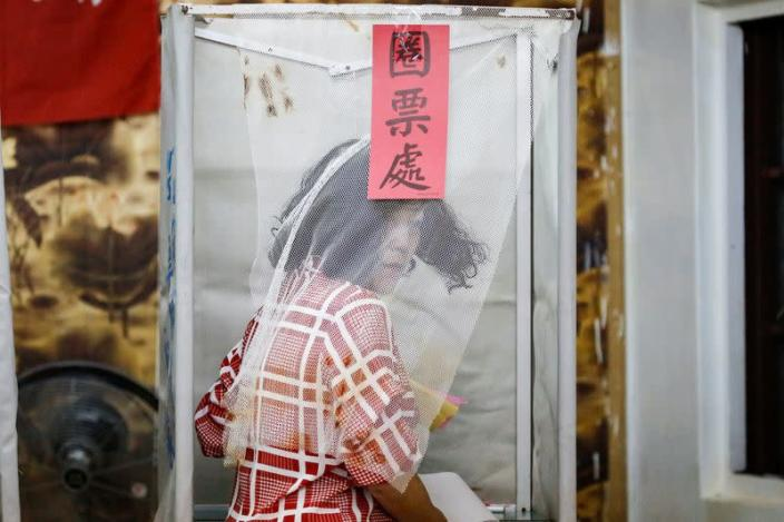 A Taiwanese voter is pictured at a polling booth during the general elections in Kaohsiung