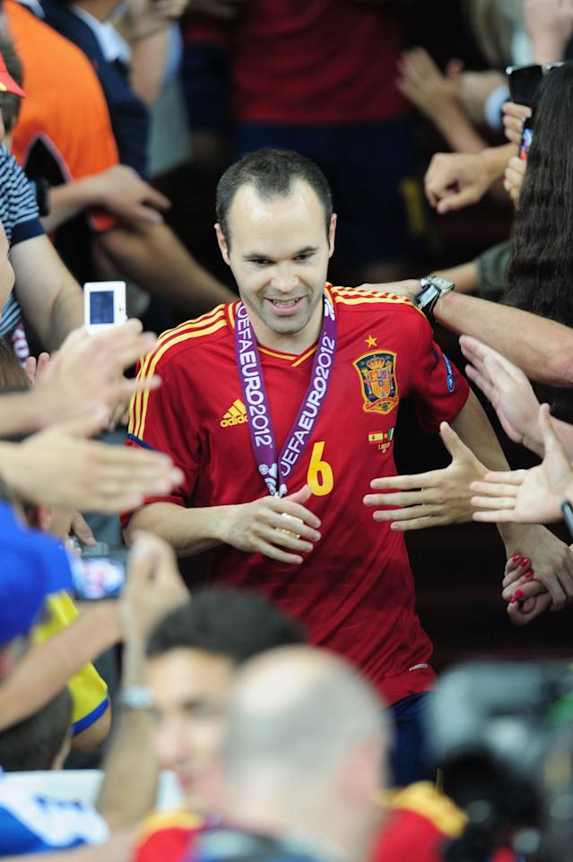 KIEV, UKRAINE - JULY 01: Andres Iniesta of Spain celebrates their victory after the UEFA EURO 2012 final match between Spain and Italy at the Olympic Stadium on July 1, 2012 in Kiev, Ukraine. (Photo by Shaun Botterill/Getty Images)