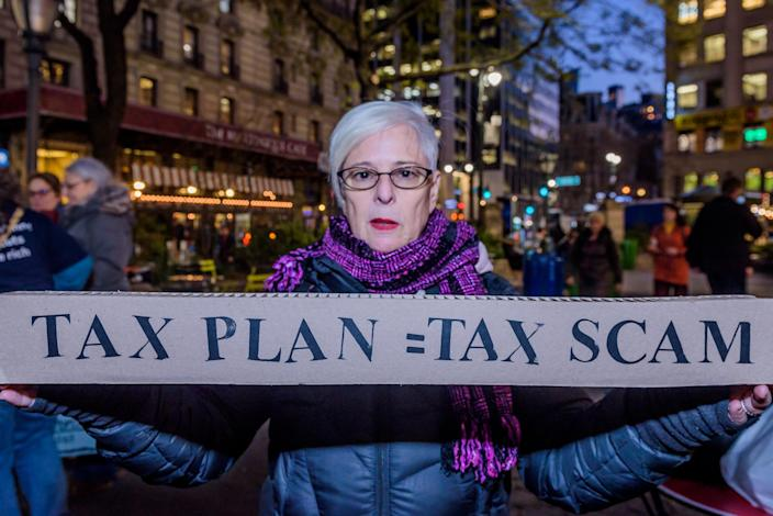 """<p>Over a hundred protesters met at Greeley Square in Midtown Manhattan on Nov. 27, 2017 and marched along 34th Street behind a """"Not One Penny of Tax Cuts for the Rich"""" banner, with """"Tax Scam"""" signs, """"Not One Penny"""" signs and giant checks made out from Medicaid or Medicare to billionaires or corporations, to raise awareness against the irresponsible tax plan that cuts Medicare and increases healthcare costs for older New Yorkers. (Photo: Erik Mcgregor/Pacific Press via ZUMA Wire) </p>"""