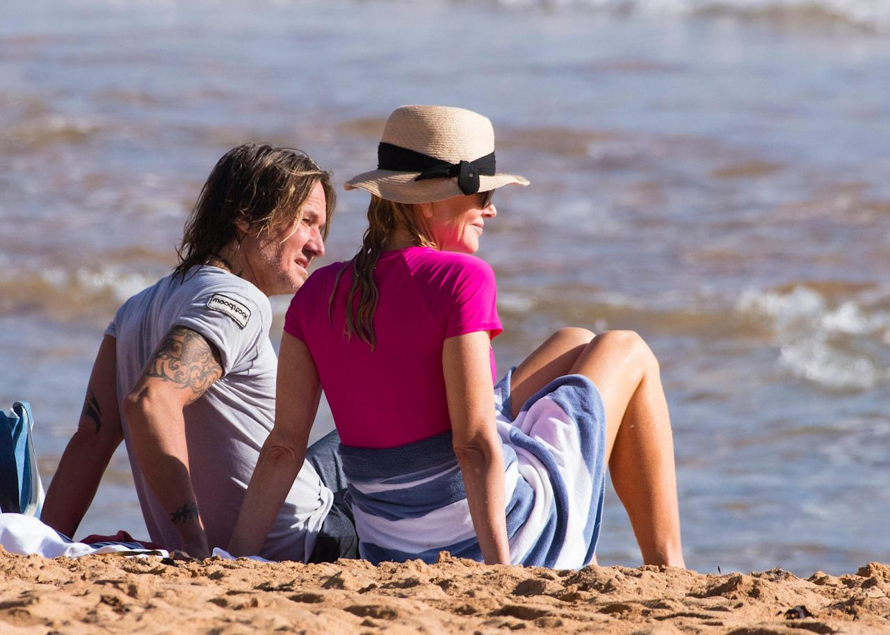 <p>Nicole and Keith sat close to one another while watching with excitement as the girls caught their first wave into the beach.</p>