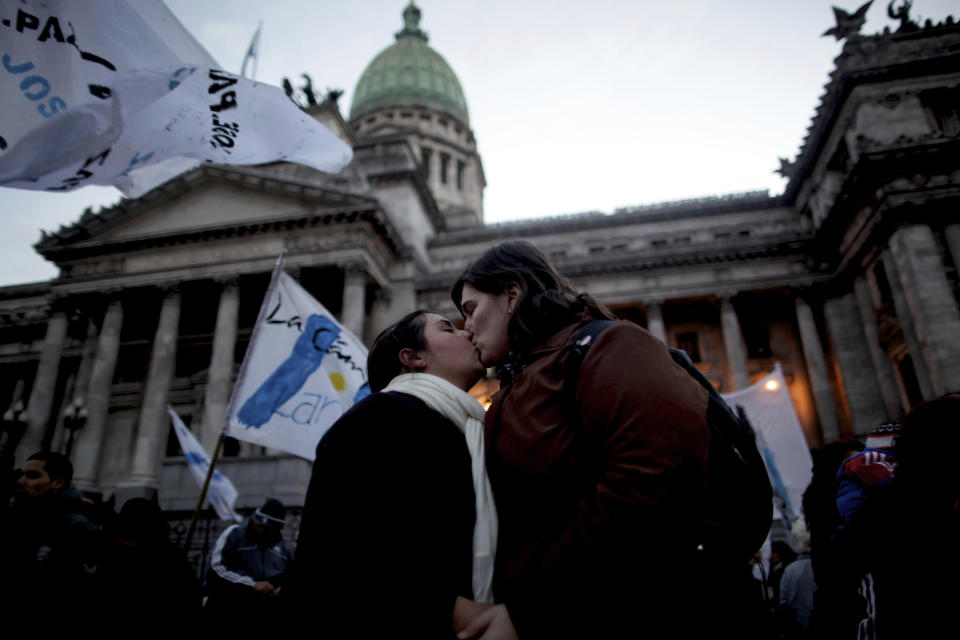 A gay couple kisses outside Argentina's congress during a rally to support a proposal to legalize same-sex marriage in Buenos Aires, Wednesday, July 14, 2010. Argentina was the first country in Latin America to legalize same-sex marriage. (AP Photo/Natacha Pisarenko)