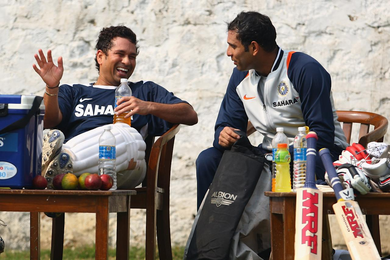 NEW DELHI, INDIA - OCTOBER 28:  Sachin Tendulkar (L) speaks with VVS Laxman during the Indian cricket team nets session at the Ferozeshah Kotla Stadium on October 28, 2008 in New Delhi, India.  (Photo by Michael Steele/Getty Images)