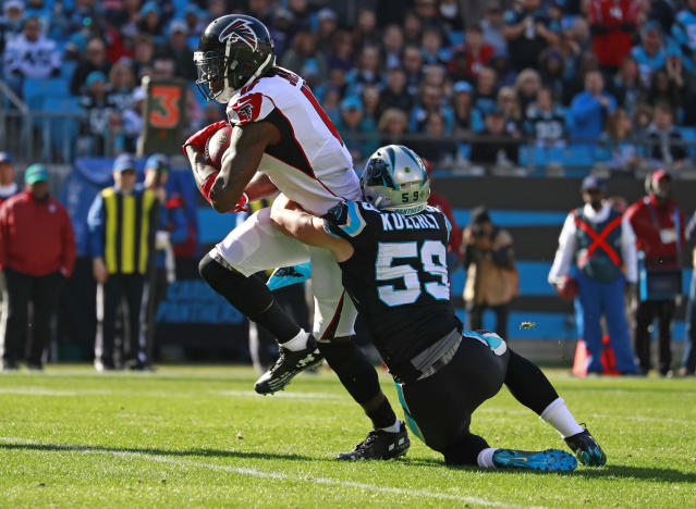 Atlanta Falcons' Julio Jones (11) is tackled by Carolina Panthers' Luke Kuechly (59) during the first half of an NFL football game in Charlotte, N.C., Sunday, Dec. 23, 2018. (AP Photo/Jason E. Miczek)