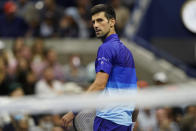 Novak Djokovic, of Serbia, looks over his shoulder during a match against Tallon Griekspoor, of the Netherlands, during the second round of the US Open tennis championships, Thursday, Sept. 2, 2021, in New York. (AP Photo/Frank Franklin II)