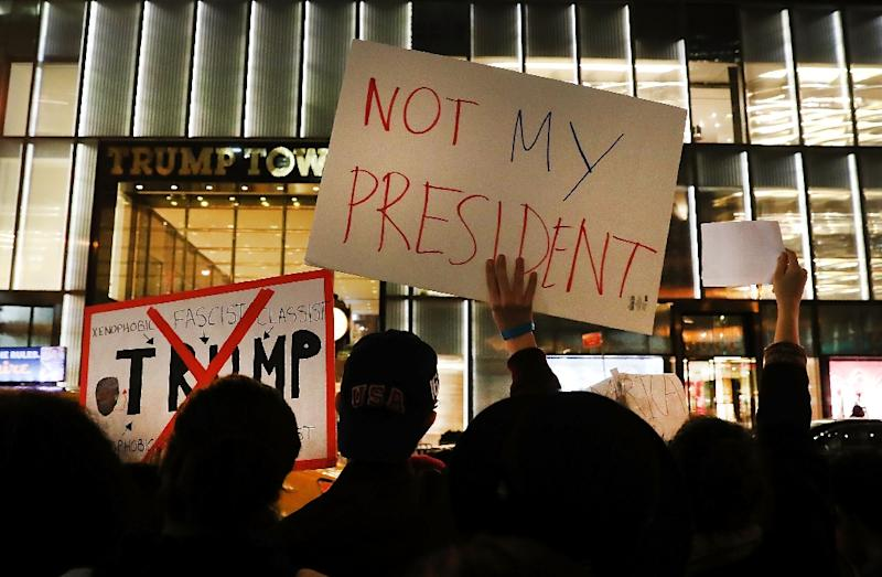 Anti-Trump protesters outside Trump Tower on New York's Fifth Avenue on November 10, 2016 (AFP Photo/Spencer Platt)