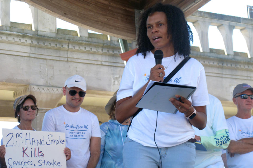 Onjewel Smith of Americans for Nonsmokers' Rights speaks at a rally Wednesday, June 30, 2021 on the Atlantic City N.J., Boardwalk calling for a permanent ban on smoking in Atlantic City's nine casinos. The coronavirus-inspired temporary ban will expire on Sunday July 4. (AP Photo/Wayne Parry)