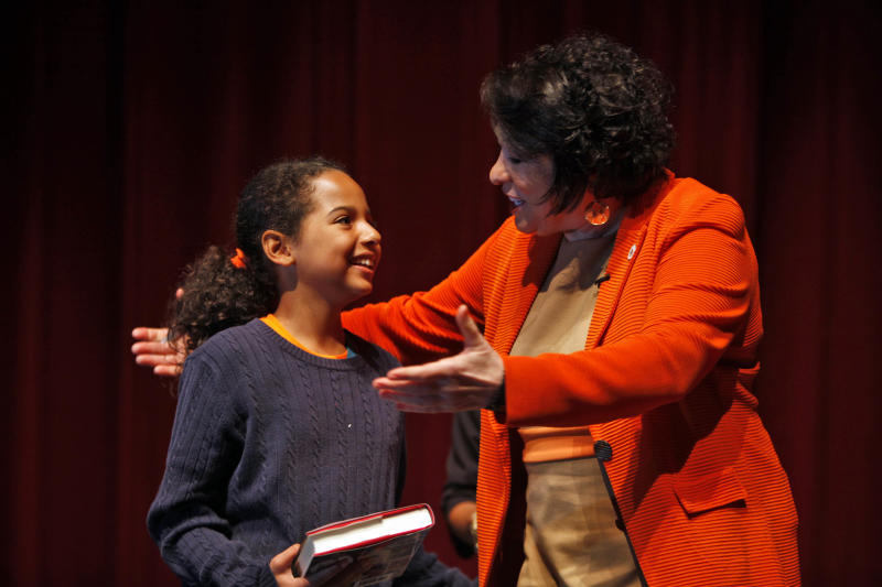 """U.S. Supreme Court Justice Sonia Sotomayor, right, speaks with Laura Vazquez at the University of Puerto Rico in San Juan, Puerto Rico, Tuesday, April 2, 2013. Sotomayor is visiting Puerto Rico to present her new memoir """"My Beloved World"""" and drawing thousands of fans in her parents' homeland. The book gives a personal account of growing up in an impoverished New York City tenement and becoming a federal judge in 1992. (AP Photo/Ricardo Arduengo)"""
