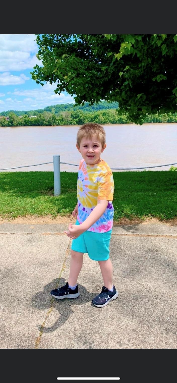 Quinn Howell, 6, of Russell, Ky., enjoys a walk along the Ohio River. Howell converted to telehealth therapy after the COVID-19 pandemic limited access to in-person therapy.