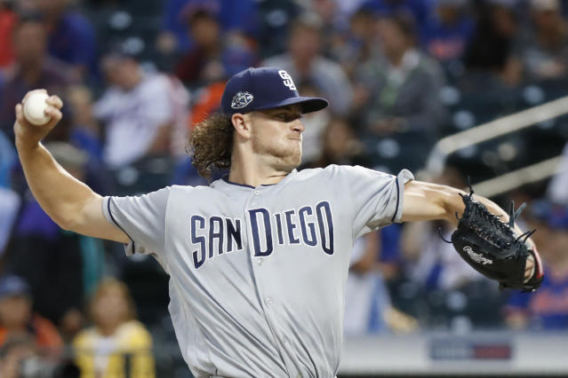 San Diego Padres starting pitcher Chris Paddack winds up during the first inning of a baseball game against the New York Mets, Tuesday, July 23, 2019, in New York. (AP Photo/Kathy Willens)