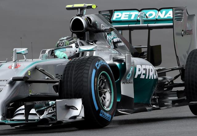 Germany's Nico Rosberg of Mercedes drives his car to qualify in pole position ahead of the British Formula One Grand Prix at Silverstone circuit, Silverstone, England, Saturday, July 5, 2014. Germany's Sebastian Vettel of Red Bull finished second and Britain's Jenson Button finished third for the British Formula One Grand Prix, which will be held on Sunday July 6, 2014. (AP Photo/ Rui Vieira)