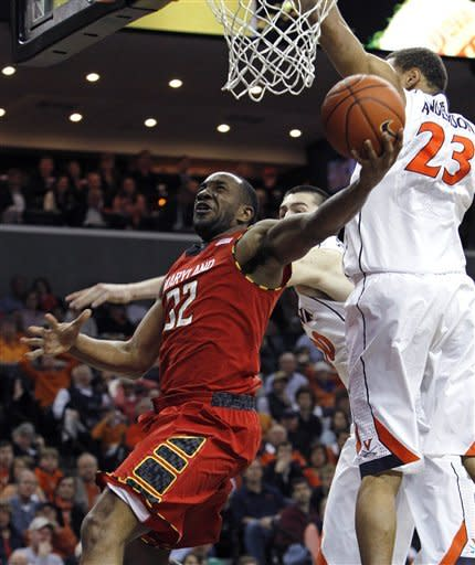 Maryland's Dez Wells shoots around Virginia guard Justin Anderson in the first half of an NCAA college basketball game in Charlottesville, Va., Sunday, March 10, 2013. (AP Photo/Norm Shafer)