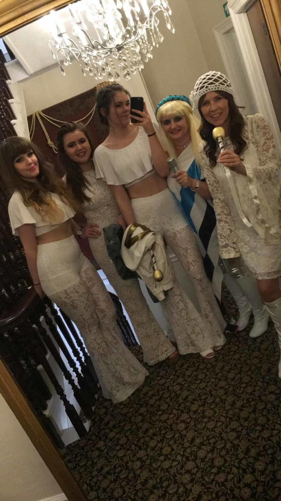 Jane and her friends and family dressed up for her ABBA themed hen party (Collect/PA Real Life).
