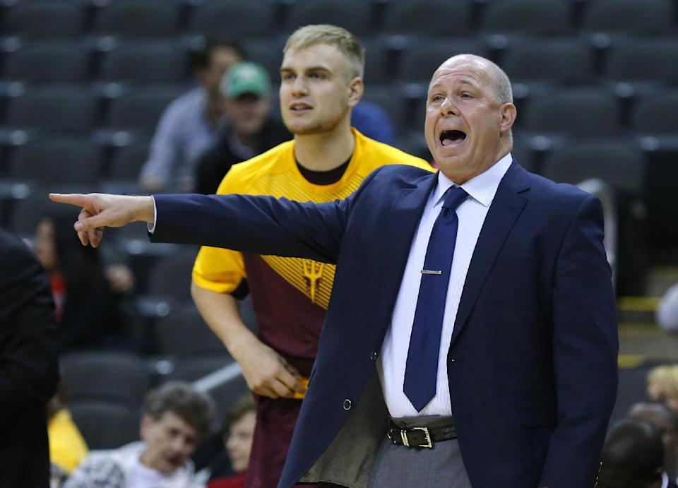 Arizona State head coach Herb Sendek directs his team during the first half of the CBE Hall of Fame Classic college baseball game against Maryland Monday, Nov. 24, 2014, in Kansas City, Mo. (AP Photo/Ed Zurga)