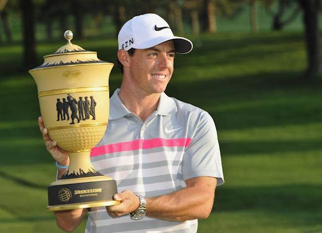 Rory McIlroy poses with the championship trophy after winning the Bridgestone Invitational golf tournament, Sunday, Aug. 3, 2014, in Akron, Ohio. McIlroy won with a final round 66 to beat Sergio Garcia by two strokes. (AP Photo/Phil Long)