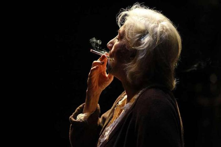 """TUESDAY, NOVEMBER 1, 2011 –– Grace (Olympia Dukakis) sneaks a drag off a cigarette in a rare moment alone in her apartment during the play """"Vigil, """" at the Mark Taper Forum."""